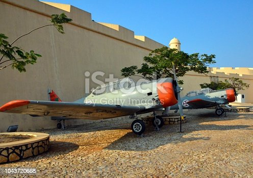 Luanda, Angola: Pair of T-6 Texan aircraft outside Sao Miguel fortress - former Portuguese Air Force aircraft, used in the African campaigns - Monte de São Paulo / Morro da Fortaleza
