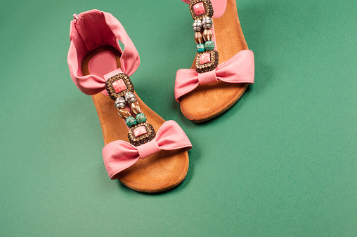 Pair of the New Pink Sandals Isolated on Green