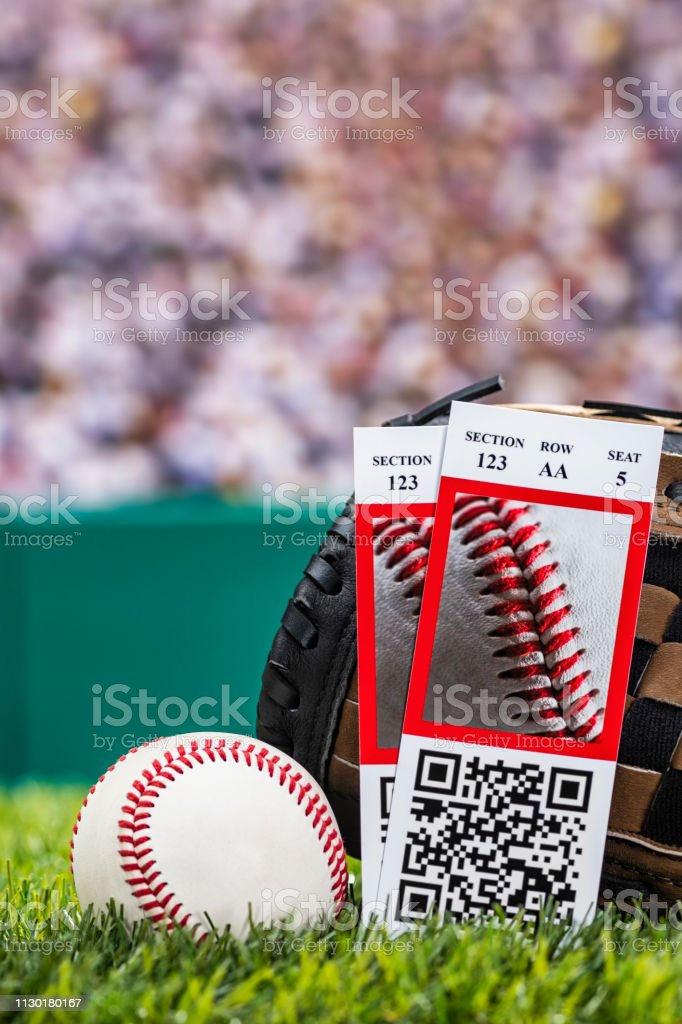A low angle view of a pair of ticket stubs to a baseball game, they...