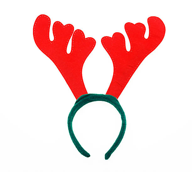 Pair of toy reindeer horns. Isolated on a white background. stock photo