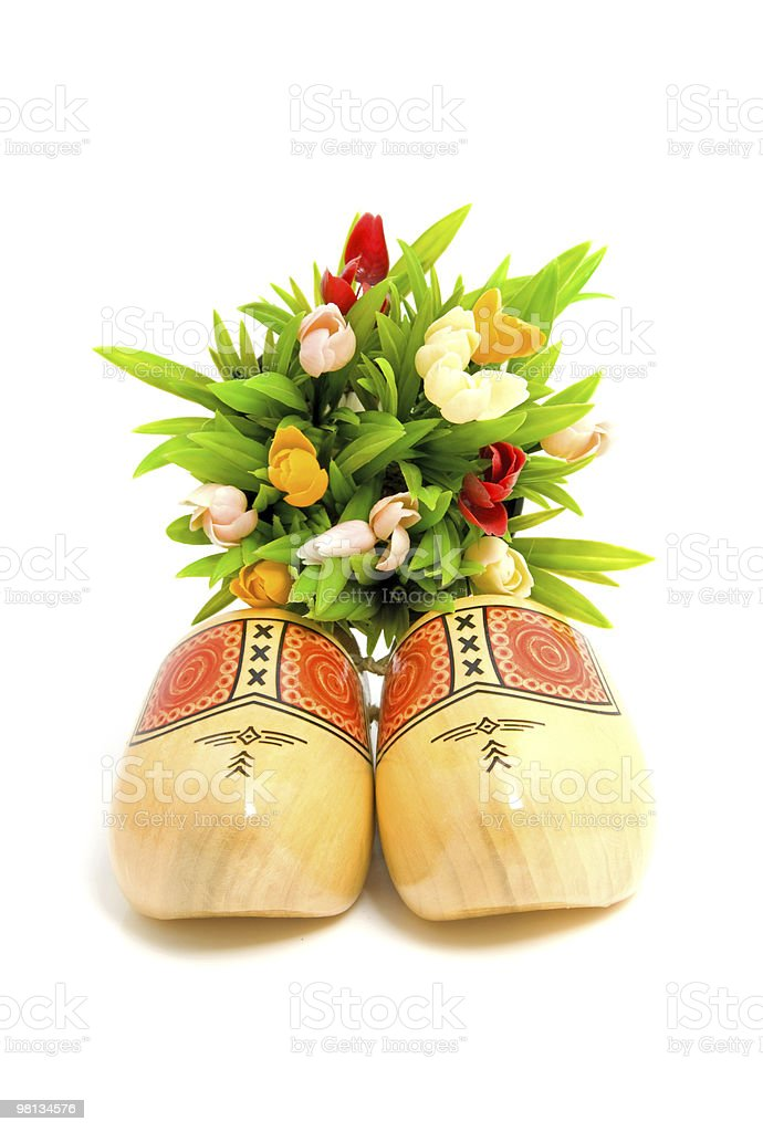 pair of traditional Dutch yellow wooden shoes royalty-free stock photo