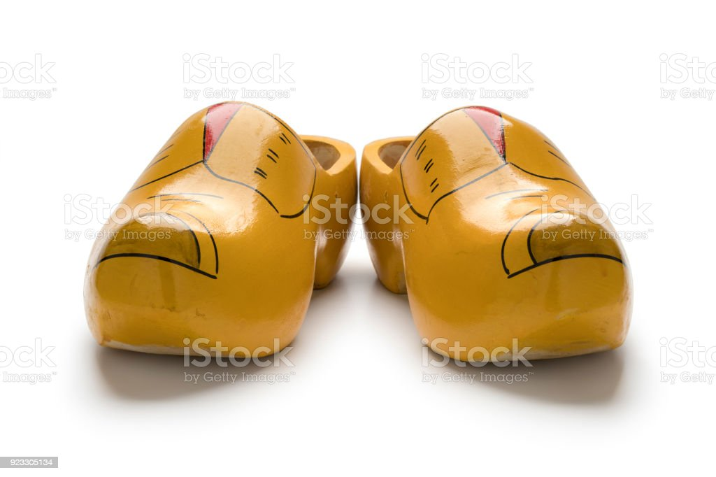 Pair of traditional yellow Dutch wooden shoes stock photo
