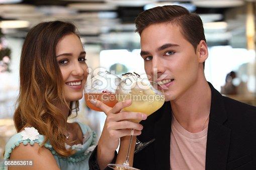 istock A pair of trendy lovers having dinner in fusion restaurant 668863618