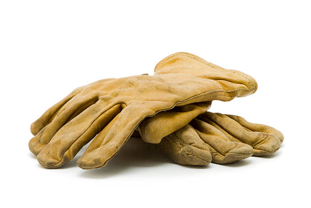 A pair of used, yellow work gloves stock photo