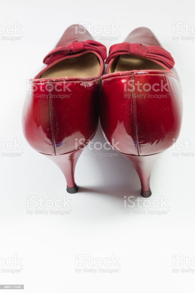 Pair of vintage women's ruby red shoes viewed from the rear, isolated on white stock photo