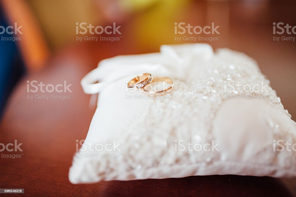 pair of wedding rings with bokeh background royalty-free stock photo