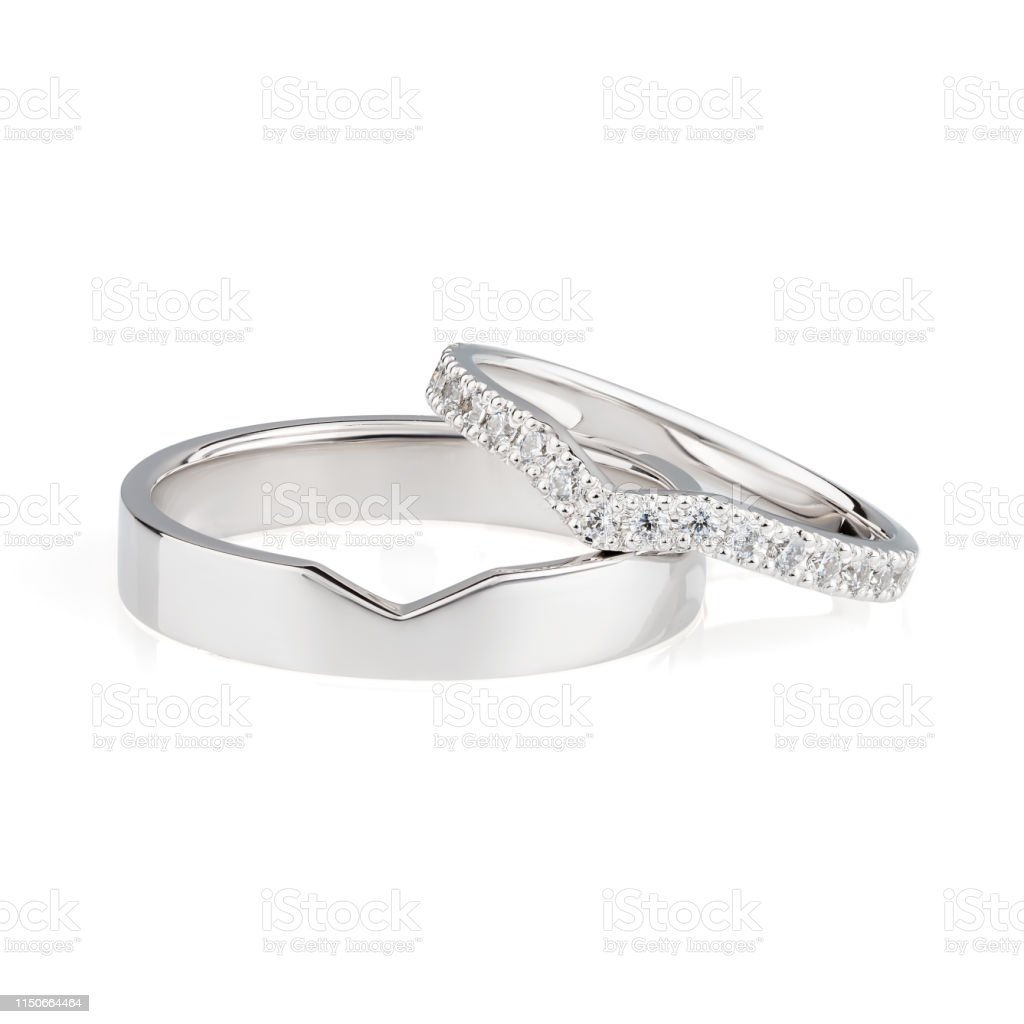 This is a graphic of Pair Of White Gold Wedding Rings With Diamonds On Female Ring Isolated On White Background Stock Photo - Download Image Now