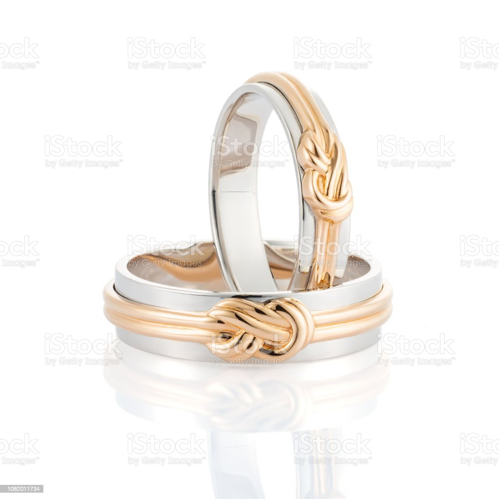 Pair Of White Gold Wedding Rings With Pink Gold Knot Isolated On White Background Stock Photo Download Image Now Istock