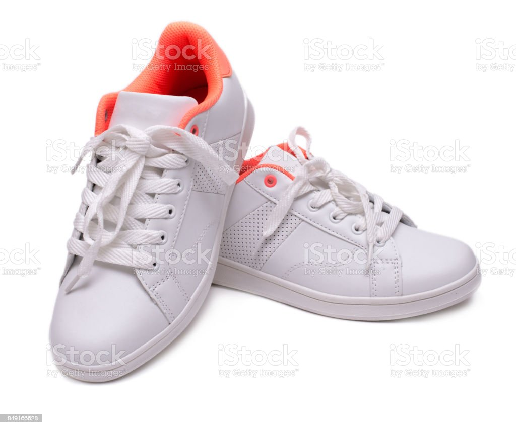 Pair of white sneakers isolated on white background. Sport shoes. stock photo