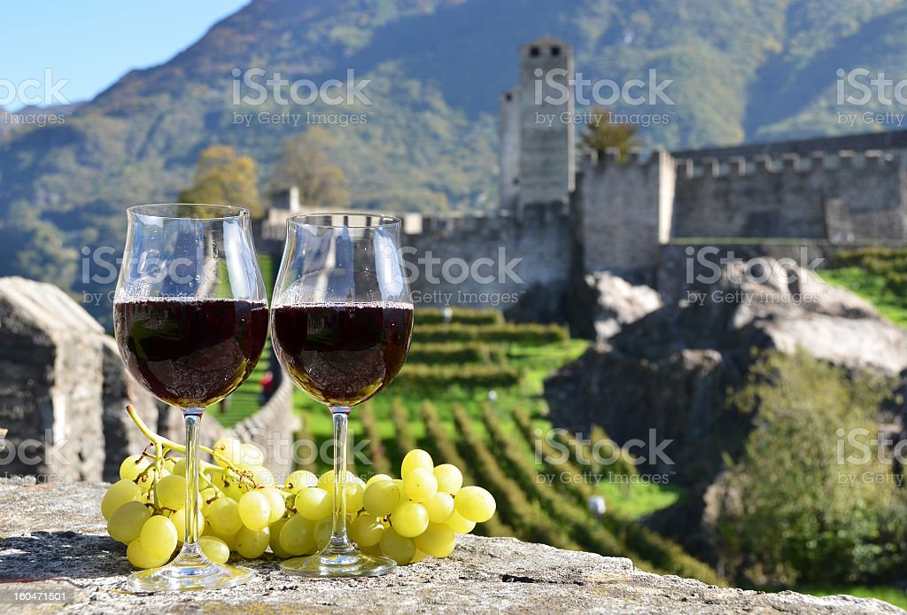 A pair of wineglasses and grapes stock photo
