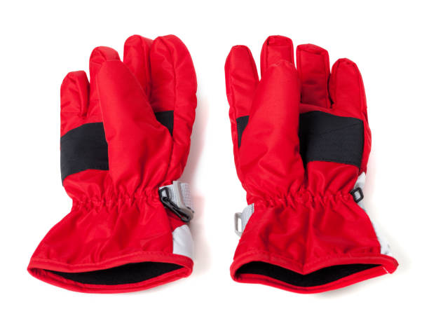 pair of winter ski gloves - sports glove stock photos and pictures
