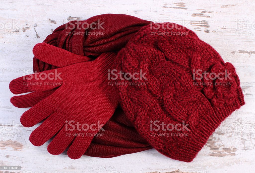 Pair of woolen gloves, cap and shawl for woman stock photo