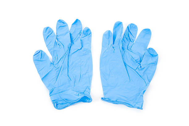 A pair of wrinkled blue latex gloves Blue Glove with white background surgical glove stock pictures, royalty-free photos & images