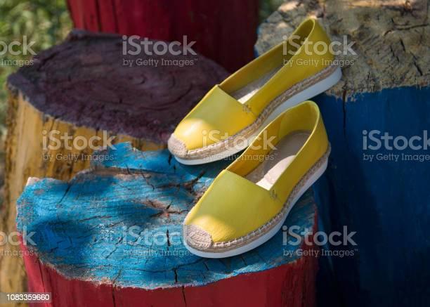 Pair of yellow espadrilles in nature picture id1083359660?b=1&k=6&m=1083359660&s=612x612&h=yek5gz 8bxzjo1c9irbhjrhutg2rzvgfsobaa2l6c80=