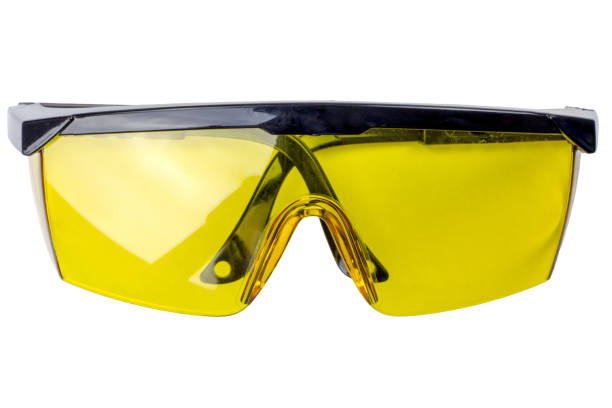 Pair of yellow safety goggles Pair of yellow safety goggles cut out on white a background. Tools series. protective eyewear stock pictures, royalty-free photos & images