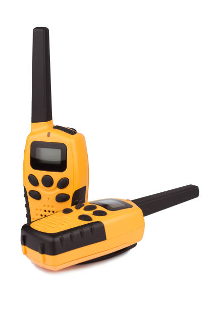 pair of yellow walkie talkie isolated - ricetrasmettitore foto e immagini stock