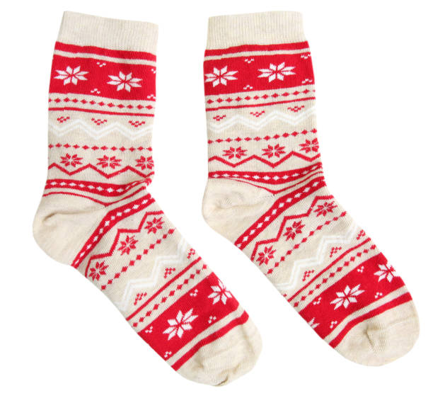 Pair socks winter holiday ornaments isolated. Pair socks with red winter holiday ornaments isolated. sock stock pictures, royalty-free photos & images