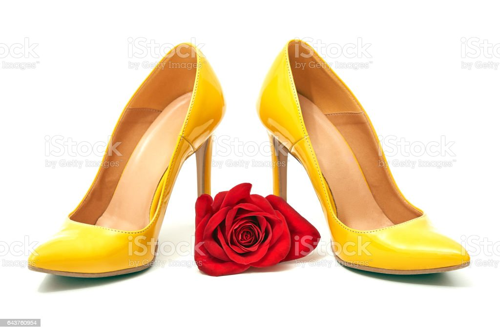 A pair yellow of  women's heel shoes stock photo