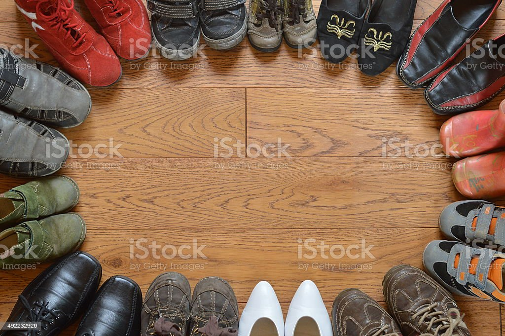 pairs of different shoes standing in a circle stock photo