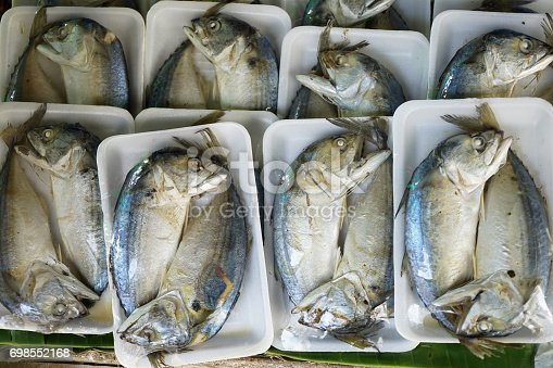 Pairs of salted and steamed short mackerel or Pla thu packed and wrapped in rectangle foam tray for selling in local market, Chonburi, Thailand