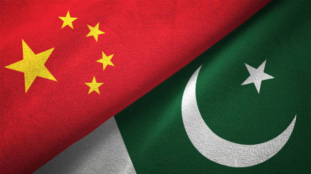 pakistan and china two flags together realations textile cloth fabric texture - pakistano foto e immagini stock