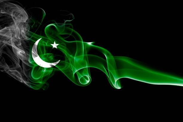 pakistan smoke flag - pakistani flag stock photos and pictures