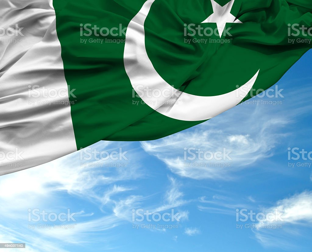 Pakistan waving flag on bad day stock photo
