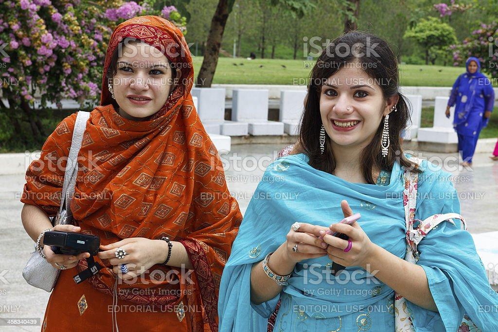 Pakistan Women at Faisal Mosque, Islamabad stock photo
