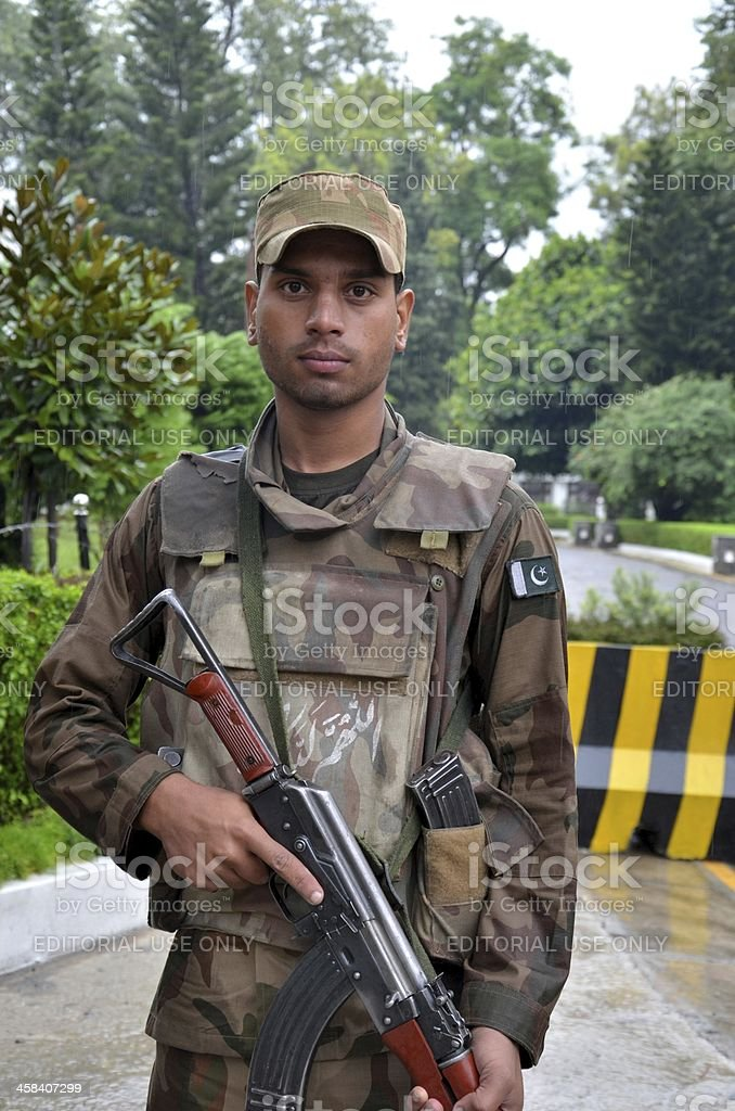 Pakistani infantry soldier stands guard in Swat Valley, Pakistan. stock photo