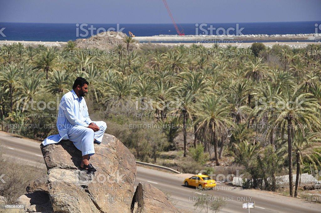 Pakistani man overlooking the road stock photo
