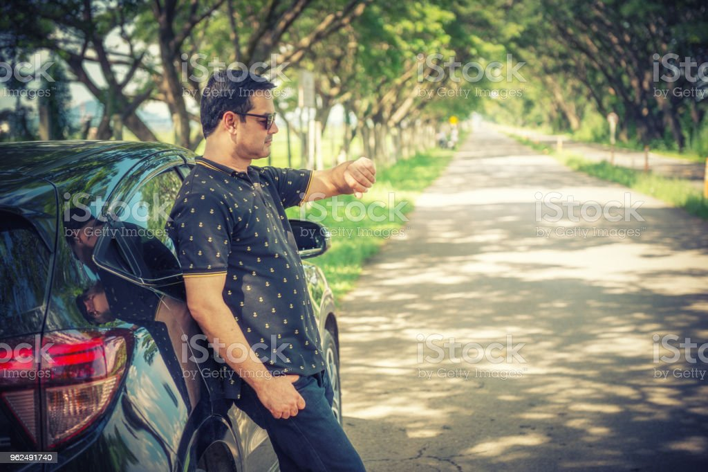 pakistani muslim Man standing near car and looking watch is wait someting - Royalty-free Adult Stock Photo