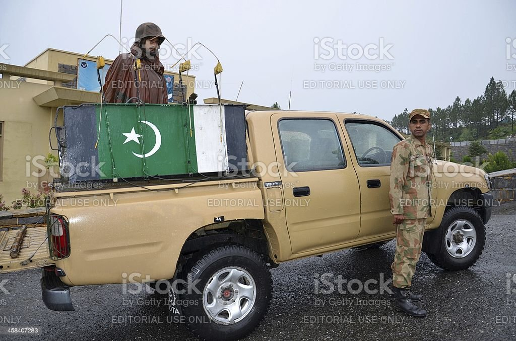 Pakistani soldiers prepare for patrol on pick-up: Swat Valley stock photo