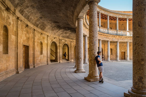 Palace of Charles V in the Alhambra Granada Spain Tourists enjoy the Palace of Charles V in the Alhambra, Granada, Spain on a sunny day. palace of charles v stock pictures, royalty-free photos & images
