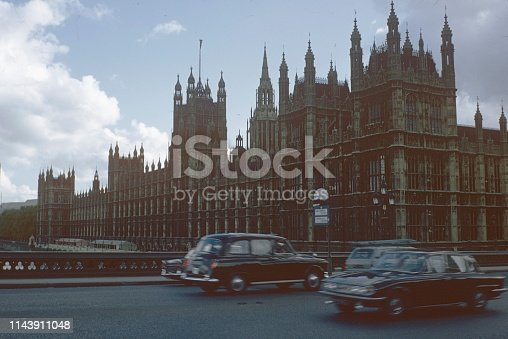 London, England, UK, 1972. Palace of Westminster in London. Also: road traffic.