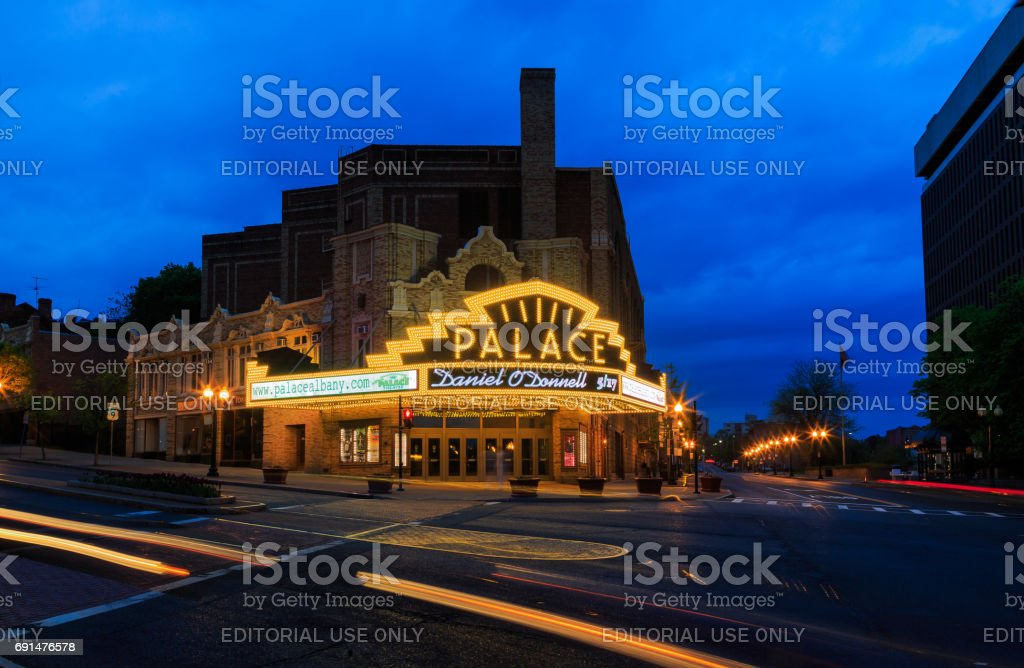 Palace Theater Albany NY on a quiet rainy Saturday night Palace Theater in Albany NY at the blue hour of sunset. Car trails, lights, reflections, but no show tonight. Downtown Albany Saturday evening. Albany - New York State Stock Photo