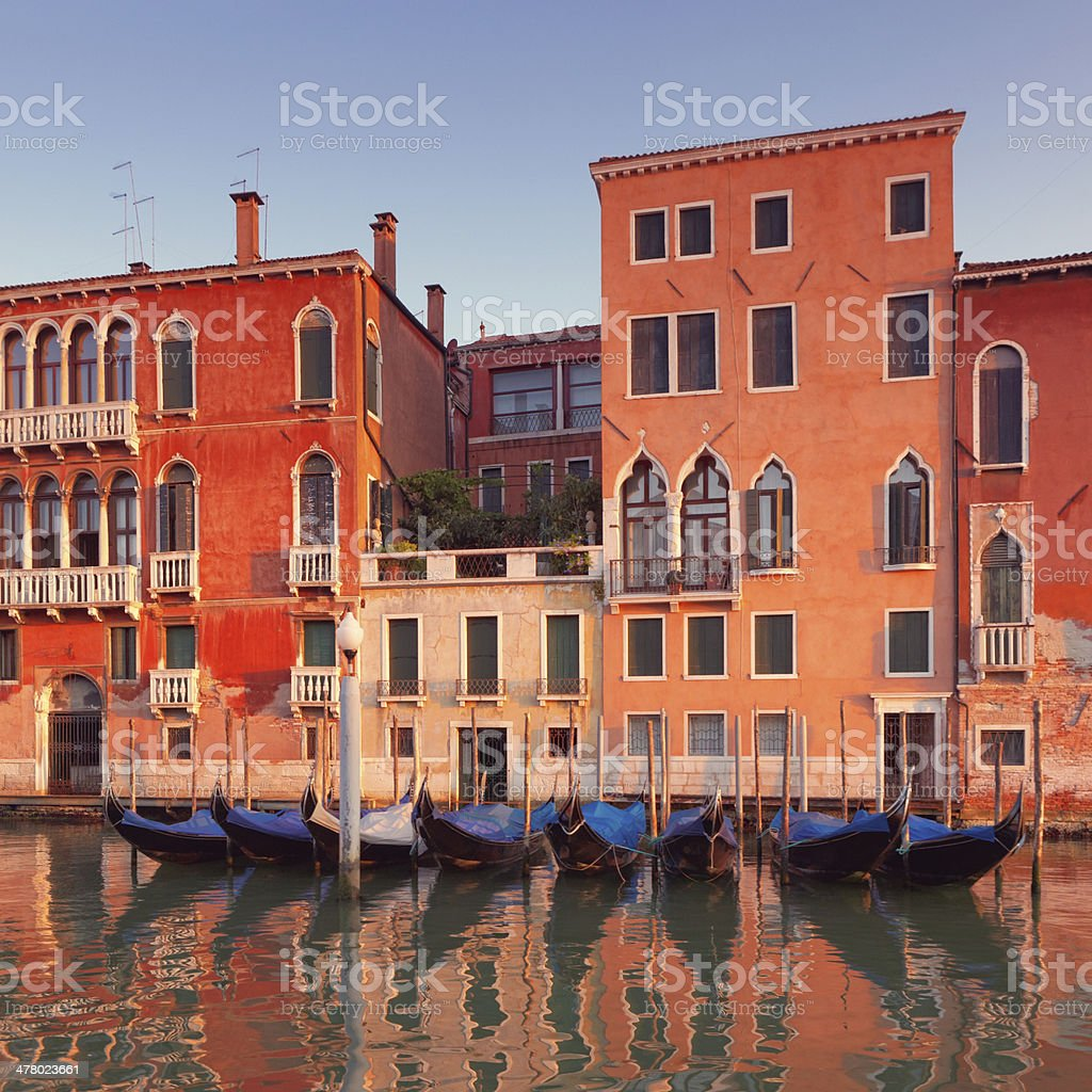 Palaces along the Grand Canal in Venice with docked gondolas royalty-free stock photo