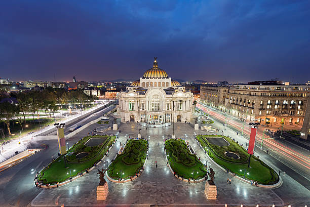 """Palacio de Bellas Artes in Mexico City """"Evening at the Palacio de Bellas Artes (Spanish for Palace of Fine Arts). Mexico City's main opera and theatre house. A extravagant marble neoclassical structure inaugurated in 1934. Mexico City, Mexico."""" fine art statue stock pictures, royalty-free photos & images"""