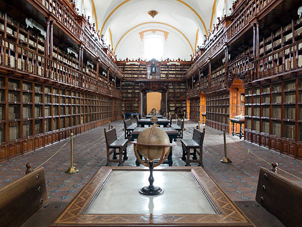Biblioteca Palafoxiana in Puebla, Mexico Puebla, Mexico - January 10, 2015: View along the main room of the Biblioteca Palafoxiana library. puebla state stock pictures, royalty-free photos & images