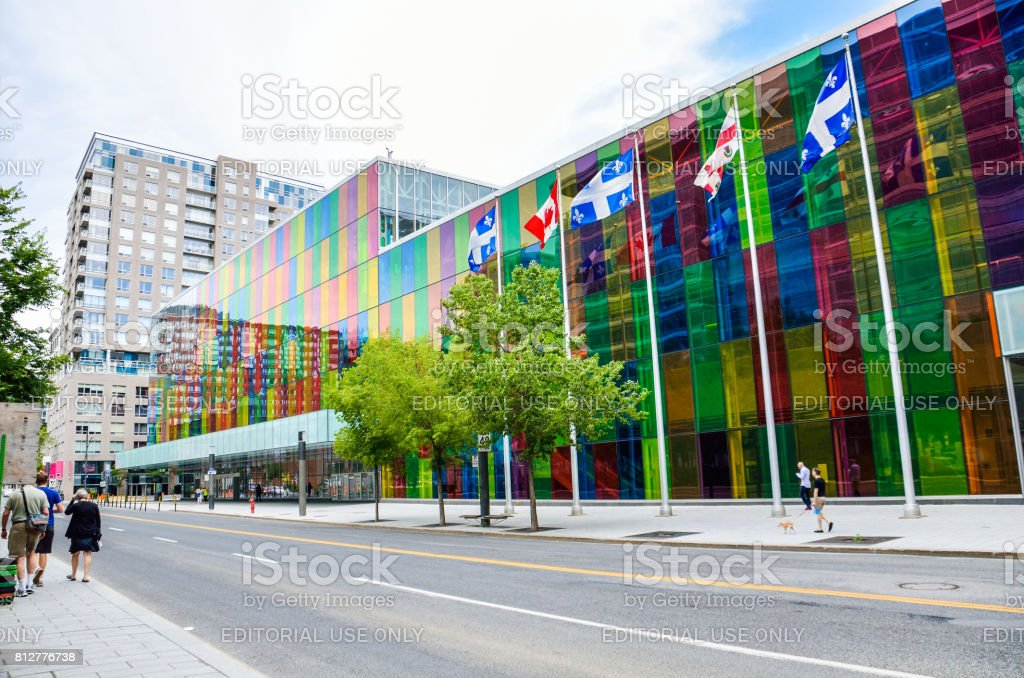 Palais des congres convention center colorful multicolored building in downtown old town of city with flags stock photo