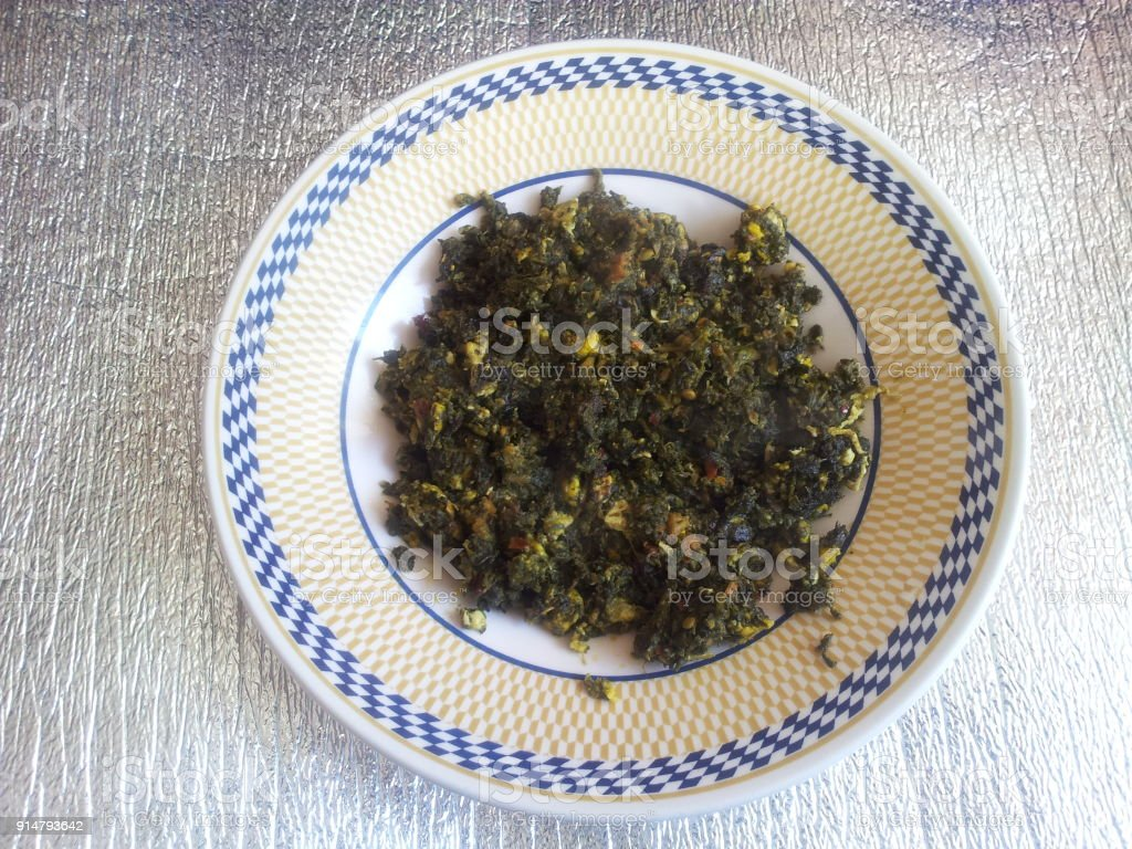 Palak Saag, a traditional Pakistani cuisine, served in a ceramic plate stock photo