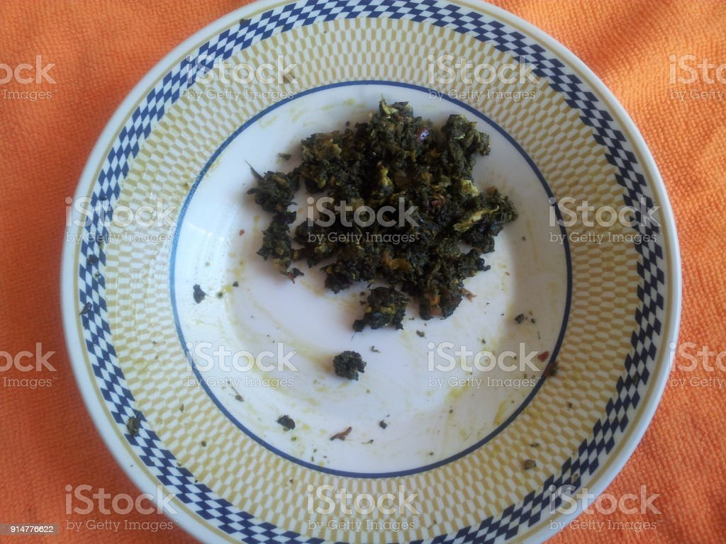 Palak Saag served in a ceramic plate on orange background stock photo