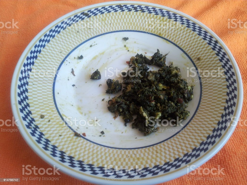 Palak Saag,served in a ceramic plate on orange background stock photo