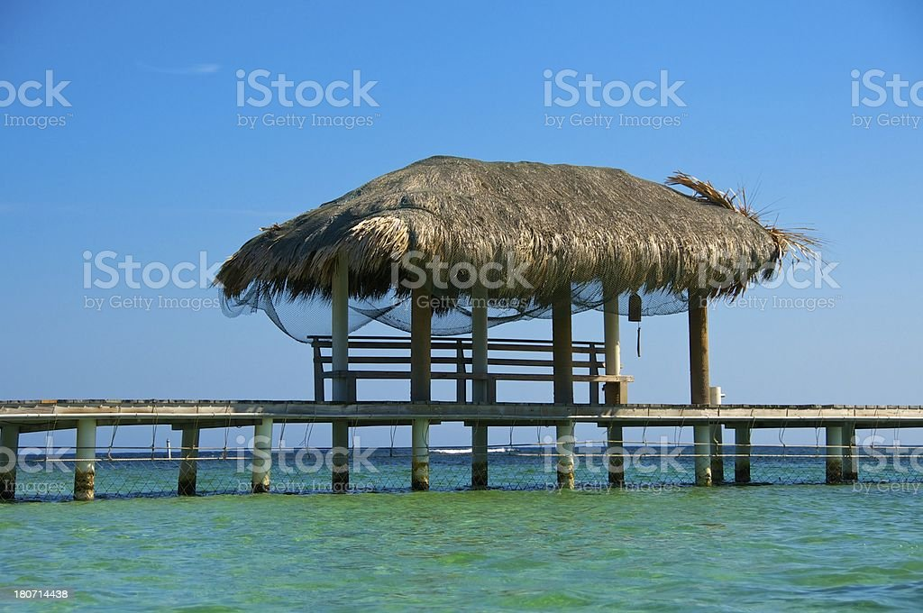 Palapa on Turquoise Water royalty-free stock photo