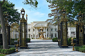 istock Palatial mansion with gilded gates 1277021538