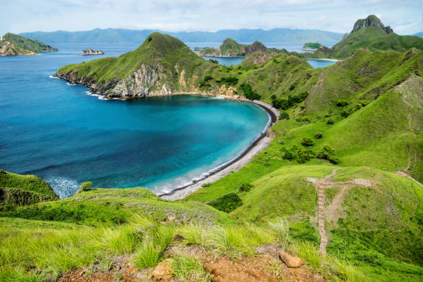 Palau Padar with ohm shaped beach in Komodo National Park, Flores, Indonesia stock photo
