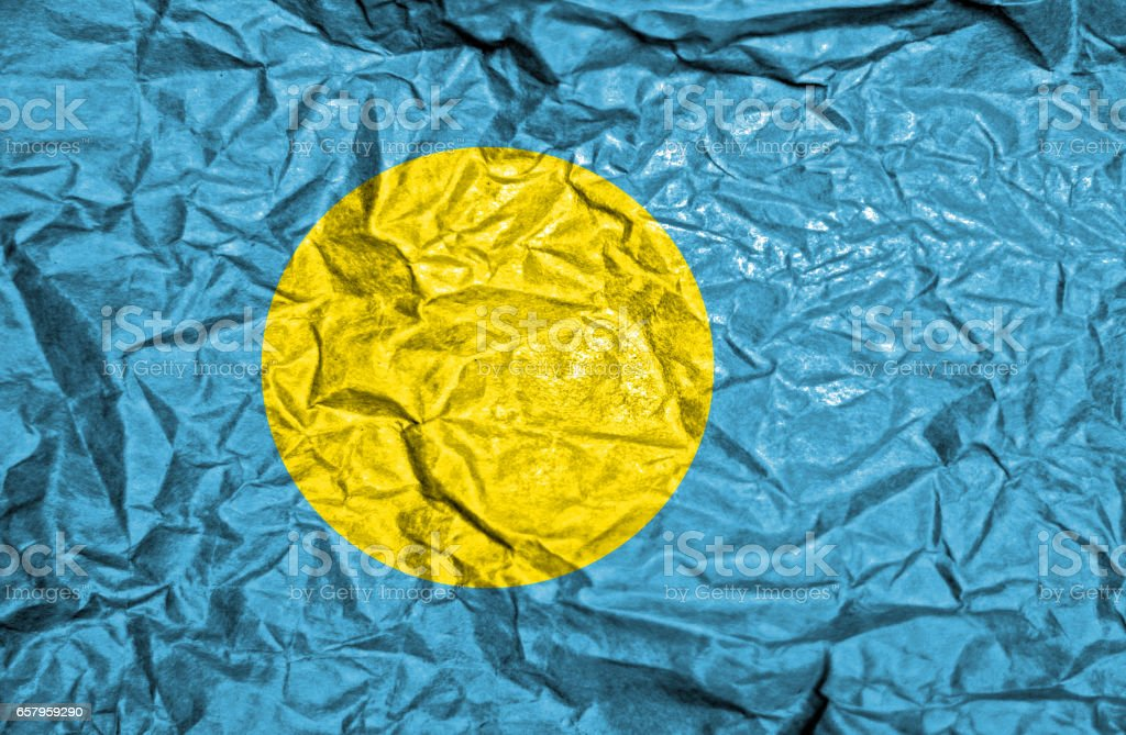 Palau vintage flag on old crumpled paper background stock photo