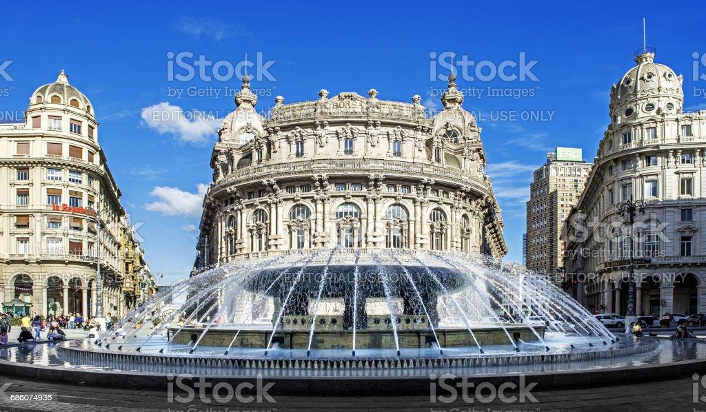 'Palazzo della Borsa' great fountain at central place in Genoa stock photo