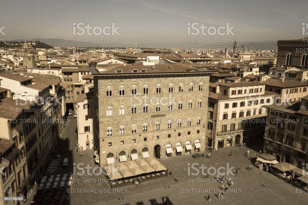 Palazzo delle Assicurazioni Generali in the Piazza della Signoria in Florence, Tuscany, Italy. Aged photo effect. royalty-free stock photo