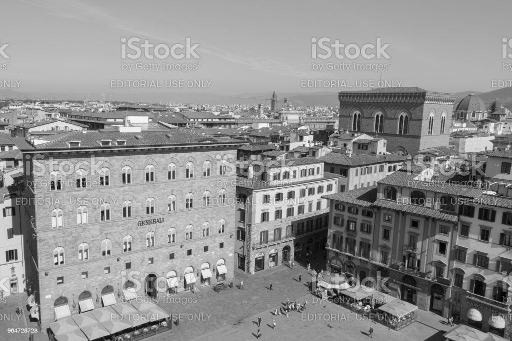 Palazzo delle Assicurazioni Generali in the Piazza della Signoria in Florence, Tuscany, Italy. Black and white effect. royalty-free stock photo