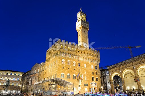 The Piazza della Signoria and the Palazzo Vecchio in Florence at night, Italy. Composite photo